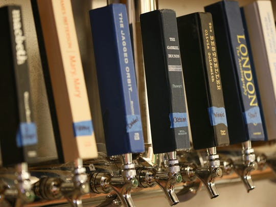 Tap handles made from book spines at the new Books & Brews location in Zionsville, Ind., during its soft opening for mug club members, Wednesday, June 29, 2016. The taproom and used bookstore is open to the public July 1, 2016.