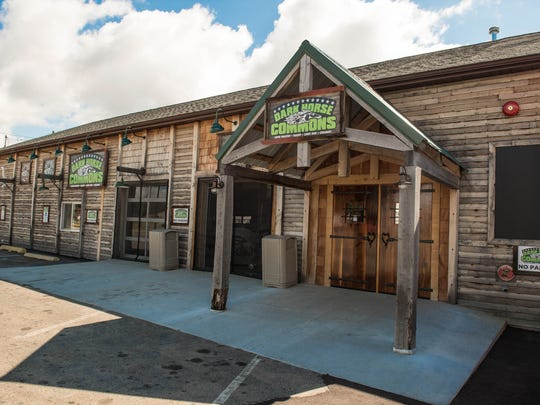 The new Dark Horse Commons which will offer speciality items made by Dark Horse such as roasted coffee, ice cream and  bakery items.  The entrance doors are made of reclaimed wooden beer barrels.