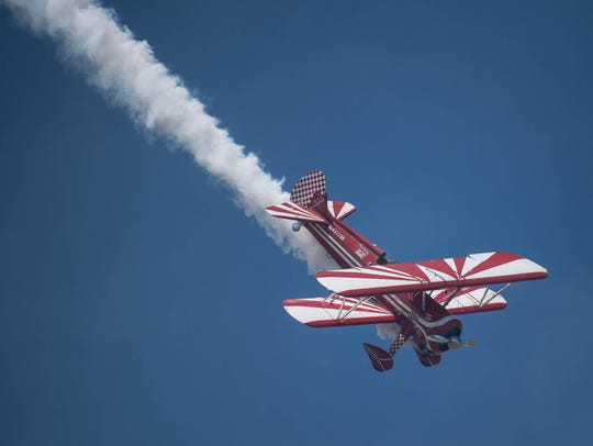 Susan Dacy makes smoke trails in her Super Stearman