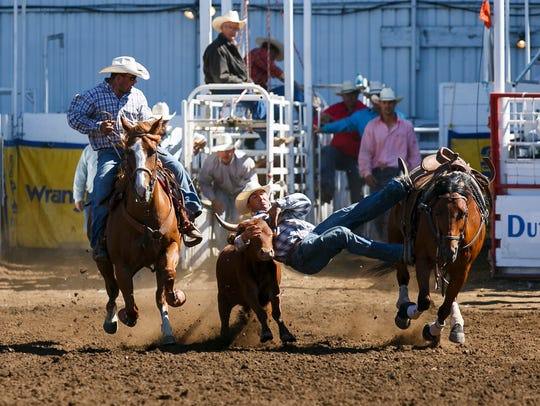 Travis Taruscio of Stanfield competes in steer wrestling