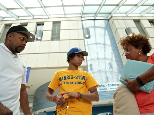 DelShawn Fowler, center, 18, of Detroit, with his mentors