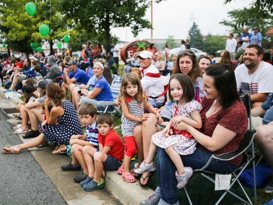 Parade goers watch the patriotic 4th of July Parade