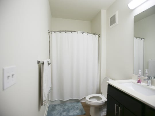 Katie Jackson and Gonzalo Castro's bathroom inside their Circa apartment in Downtown Indianapolis on July 7, 2016.