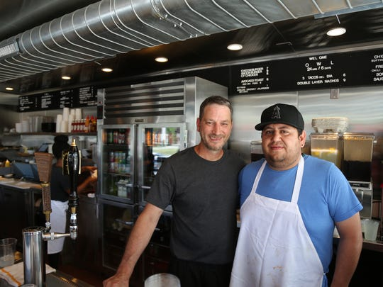 O.W.L. co-owner Joe Bongiovanni, left, and head cook Pedro Nuñez behind the counter of the 24-hour Royal Oak diner on July 13, 2016.