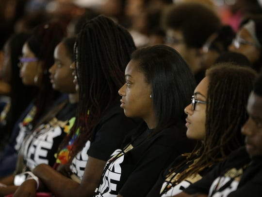 Crowd members listen as a panel discusses social media during the Black  to the Future youth forum at Indiana Black Expo Summer Celebration on July 16, 2016.