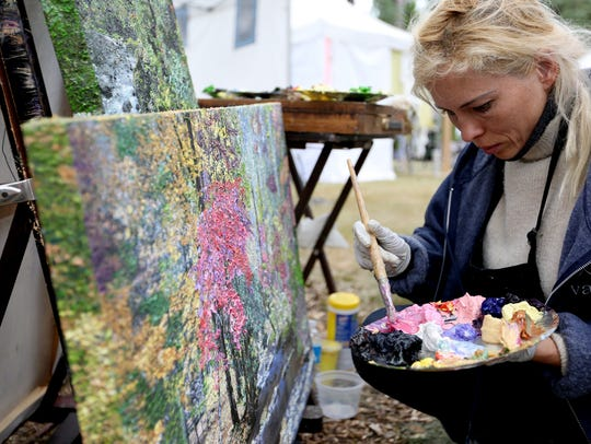 Ganna Halvorsen, of Tarzana, Calif., paints during the 67th annual Salem Art Fair and Festival at Bush's Pasture Park in Salem on Saturday, July 16, 2016.