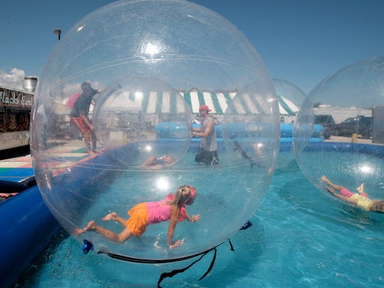 Emma Adema, 6, of Sheboygan plays in an Aquaball during Miesfeld's Lakeshore Weekend Saturday July 28, 2012 at South Pier in Sheboygan.