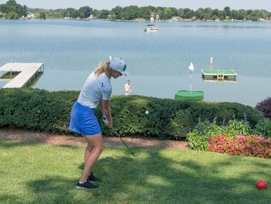 Sophia Popov from Germany tries her luck chipping onto