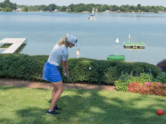 Sophia Popov from Germany tries her luck chipping onto a floating green on Goguac Lake at Battle Creek Country Club during media day for the Symetra Golf Tour to be held this weekend.
