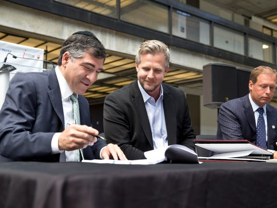 Ralph Zucker of Somerset Development, Colin Day, CEO of iCIMS, and Holmdel Mayor Eric Hinds sign documentation to make the move official.  iCIMS, a fast growing technology company, signs a lease to take up 300,000 plus-square-feet of space in the former Bell Works building.  Holmdel, NJ Wednesday, July 20, 2016@dhoodhood