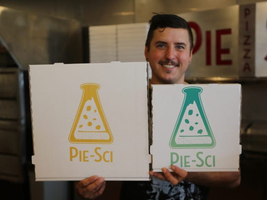 Pie Sci founder Jeremy Damaske, 33, displays the carryout pizza joint's boxes. The restaurant will be opening next to the Woodbridge Pub in Detroit.