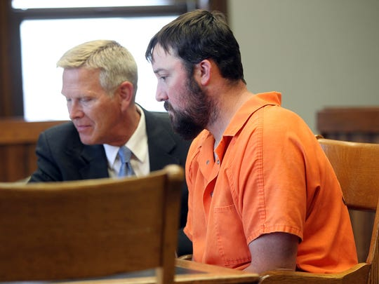 Justin DeWitt meets with his attorney, Michael Lahammer,
