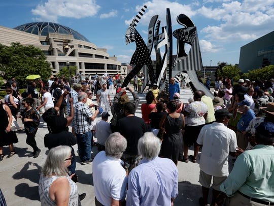 "People gathered for the unveiling of monumental new outdoor sculpture ""United We Stand,"" by Detroit's artist Charles McGee at the Charles H. Wright Museum of African American History on Saturday, July 23, 2016, in Detroit, MI."
