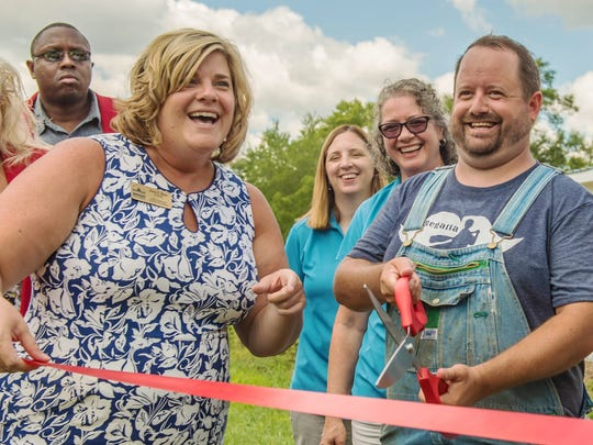 Battle Creek Chamber of Commerce President Kara Beer and Executive Director of Sprout BC Jeremy Andrews during a ribbon-cutting ceremony Tuesday at Sprout's property located at 245 N Kendall Street.