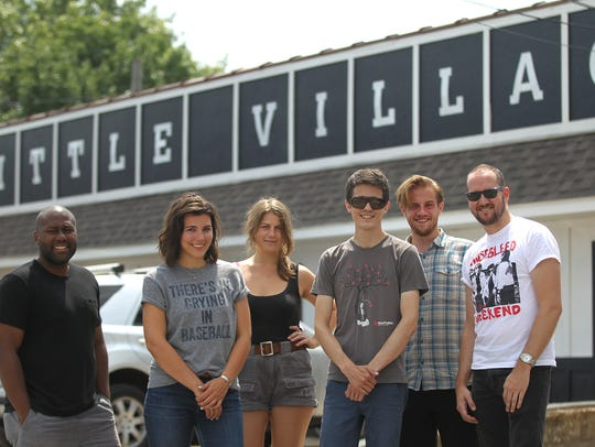 Members of Little Village's staff pose for a photo