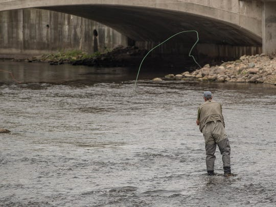 Jim Hardish casts his fly-fishing rod during an event
