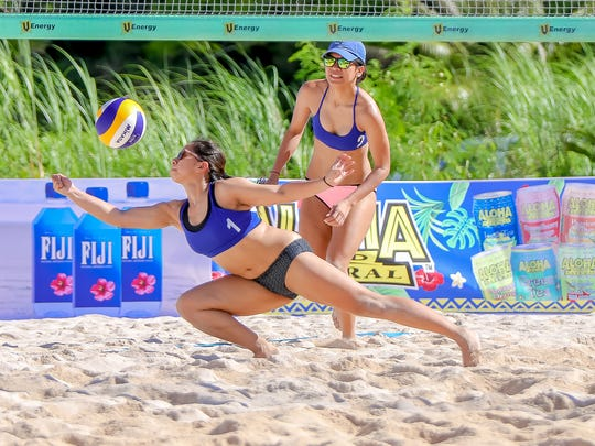 In this file photo from July 2016, Eliza Valdez reaches to keep the ball alive at the Beach Volleyball Republic Games held at the Beach Bar in Tumon.