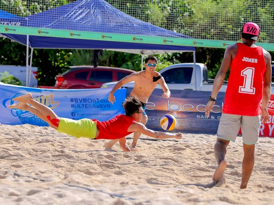 Brian Tsujii dives for a dig to keep the ball alive at the Beach Volleyball Republic game held at the Beach Bar on July 30.