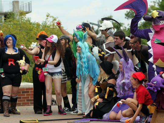 A group of Pokemon cosplayers pose for a photo at AnimeIowa