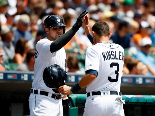 Jul 31, 2016; Detroit, MI, USA; Detroit Tigers second baseman Ian Kinsler receives congratulations from third baseman Nick Castellanos after scoring in the first inning against the Houston Astros at Comerica Park.