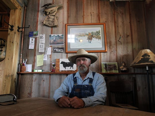 Dean Thomann operates a cattle farm in Riverside, Ia., pictured on Monday, Aug. 1, 2016. Despite having stage 4 cancer, he plans to see Willie Nelson in concert. He listens to the country star's music during chemotherapy sessions.