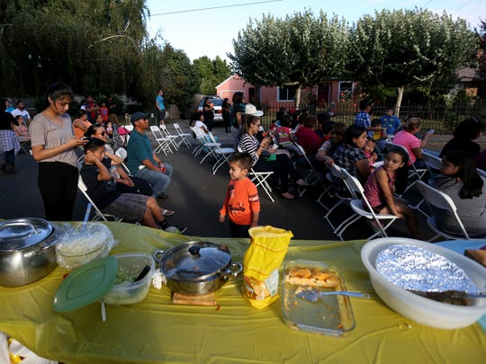Food is served during a National Night Out party on Donald St. NE in Salem on Tuesday, Aug. 2, 2016.