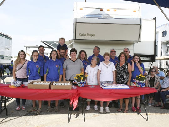 The Bohlander family along with some workers of poor Jack Amusements smile for a photo during a celebration of the 50th anniversary of the company providing rides to the Johnson County Fair on July 17, 2016.