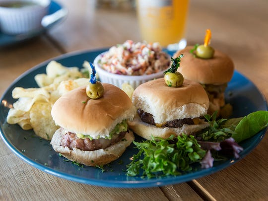 A plate of three sliders, including turkey with avocado, beef with cheddar and pork with chile-lime sauce, served with chips and champagne vinegar slow, at Wasser Brewing Company in Greencastle, Ind., Wednesday, August 3, 2016.