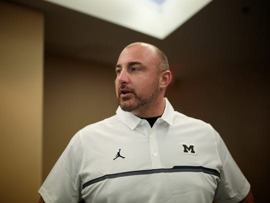 Michigan assistant coach Chris Partridge speaks to reporters during U-M football media day on Sunday, August 7, 2016, at Michigan Stadium in Ann Arbor.