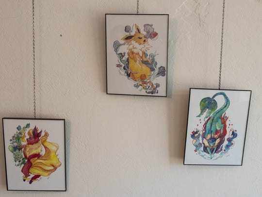 Pokemon art hung for a soft opening of at a Pokemon