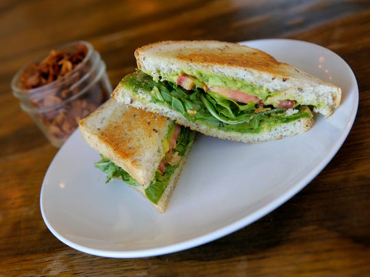 Seed to Sprout's grilled avocado sandwich and coconut bacon. The latter is made from coconut chips flavored with liquid smoke.