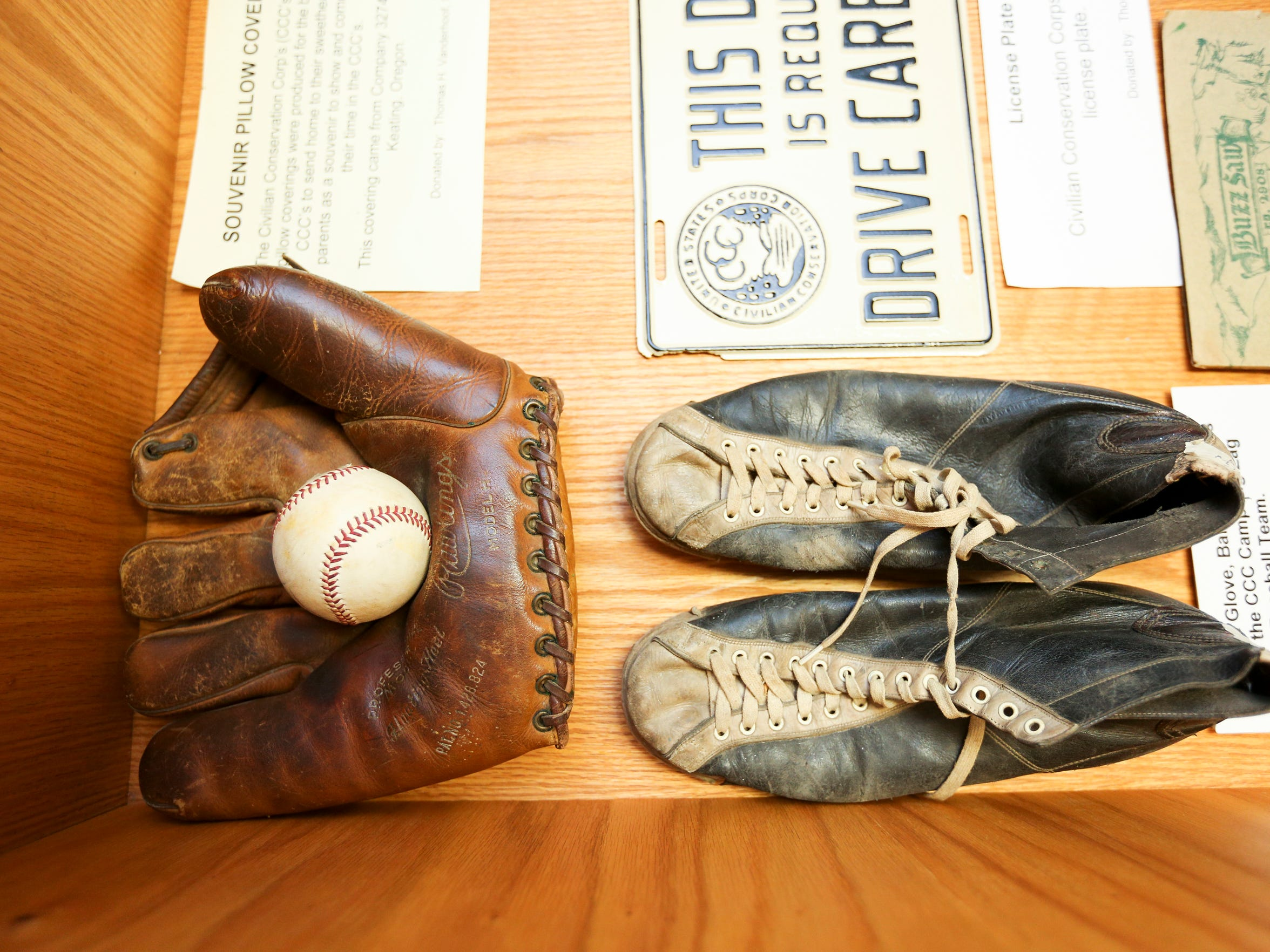 A baseball mitt and old gym shoes are some of the items