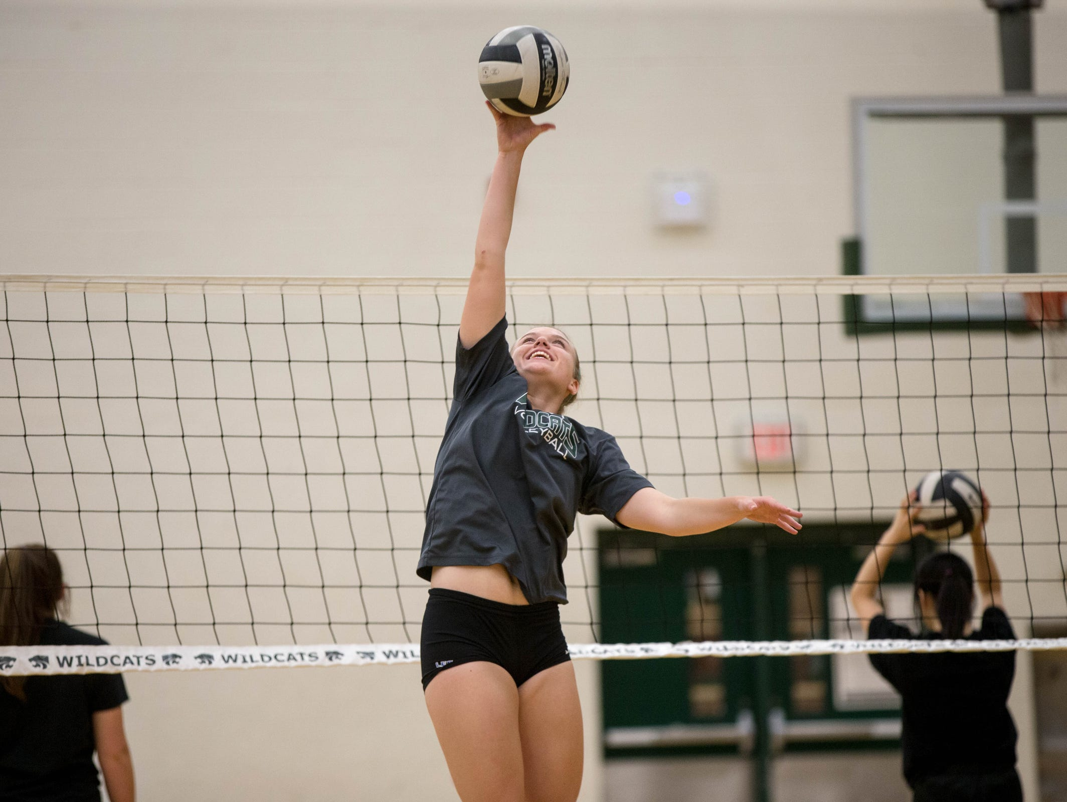 Erin O'Leary goes up for the ball during volleyball tryouts on Wednesday, Aug. 10. 2016 at Novi High School in Novi.
