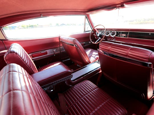 The red interior of a 1966 Dodge Charger owned by Jason