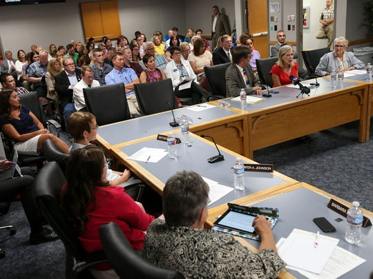 A large audience and members of the Utah State Board of Education listen as members of the Utah House Democratic Caucus Joel Briscoe, Marie Poulsen and Carol Spackman Moss, speak at a public hearing in Salt Lake City , Utah, on Tuesday, July 26, 2016. The Board hosted the hearing to gather public feedback on a new administrative rule that allows schools to hire qualified professionals without teaching experience to fill needs in the classroom.