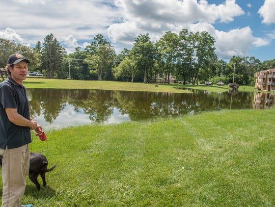 Battle Creek resident Kenneth Stone walks his dog Gracie,