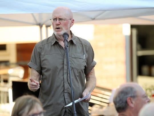 Iowa City Mayor Jim Throgmorton thanks guests and sponsors