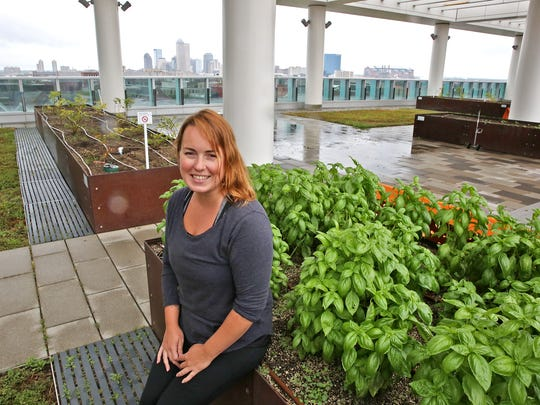 "Sky farmer Rachel White sits in her ""office"" at the Sky Farm atop the Sidney & Lois Eskenazi Hospital and Eskenazi Health building."