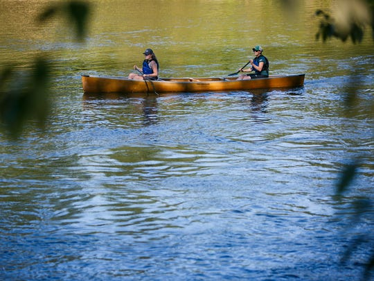 Frances Williams (left) and Erica Stock (right) paddle along the Willamette River on day two of Paddle Oregon on Tuesday, Aug. 16, 2016. The five day trip has paddlers travel from Junction City to Salem on an 85 mile journey along the Willamette River.