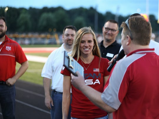 Courtney Frerichs is welcomed by fans in her home town of Nixa after returning from the Olympics. Frerichs was given a key to the town of Nixa by Mayor Brian Steele during the football game against Willard Friday, August 19, 2016. Jason Connel / For the News-Leader