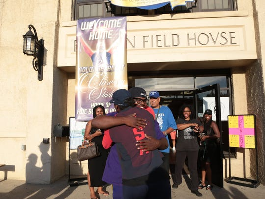 Olympic gold medalist Claressa Shields is greeted by her former coach Jason Crutchfield while visiting Berston Field House, the gym where she first started her boxing career, after arriving back to Flint with her second Olympic gold medal for women's boxing on Tuesday August 23, 2016.
