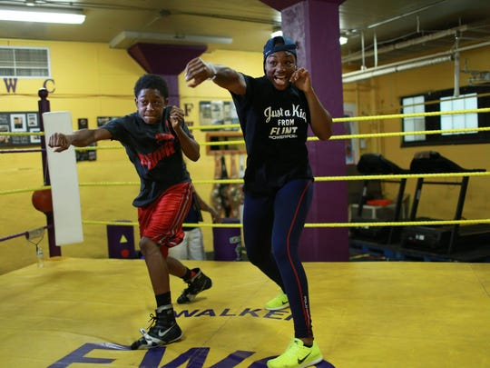 Garrett Rice Jr., 15, challenges Olympic gold medalist Claressa Shields to see whose the fastest while visiting Berston Field House, the gym where she first started her boxing career, after arriving back to Flint with her second Olympic gold medal for women's boxing on Tuesday August 23, 2016. Rice has been working out at the boxing gym since he was six years-old and has known Shields.