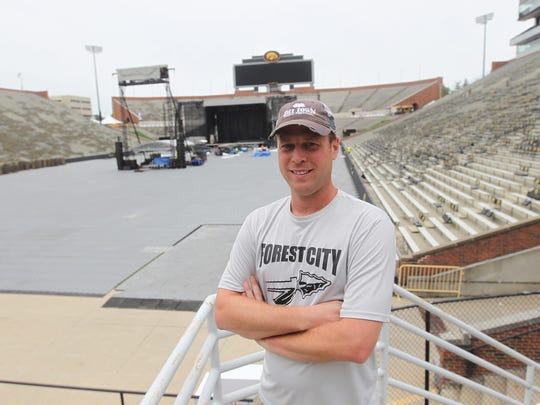 Gary DeWaard, producer for Back Porch Revival, poses for a photo at Kinnick Stadium on Thursday, Aug. 25, 2016.