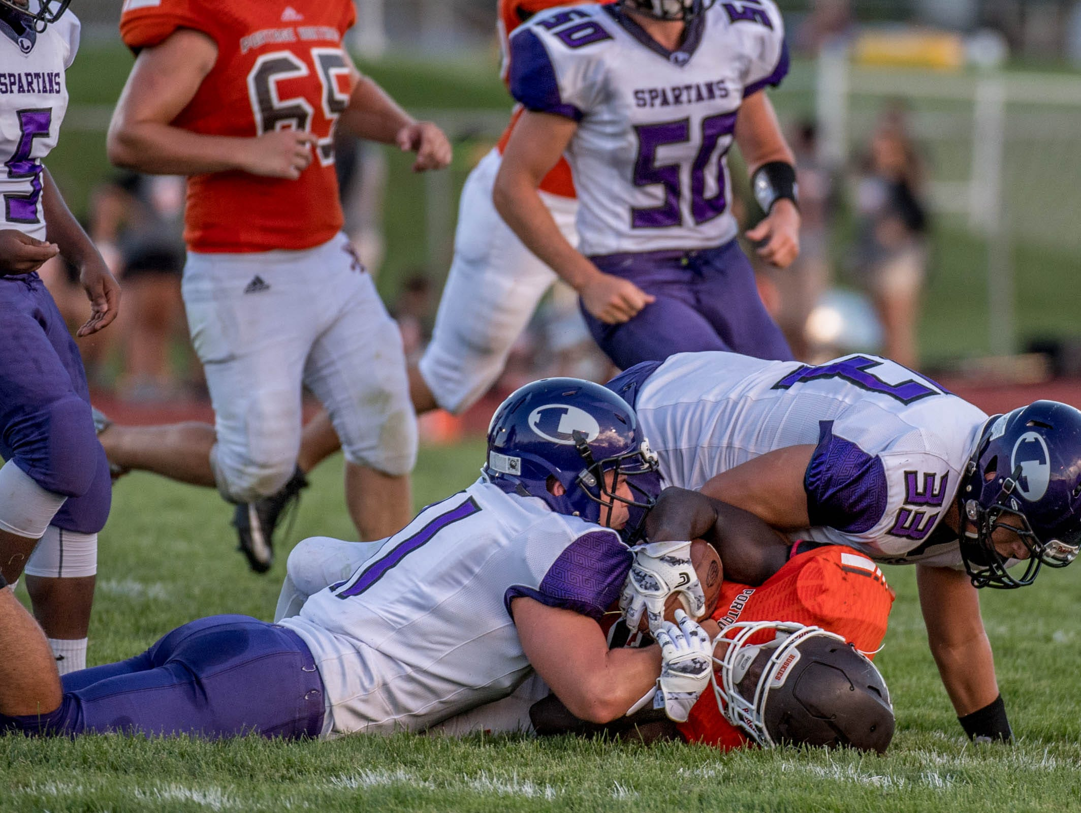 Lakeview tacklers stop the Portage Northern ball carrier on Thursday evening.