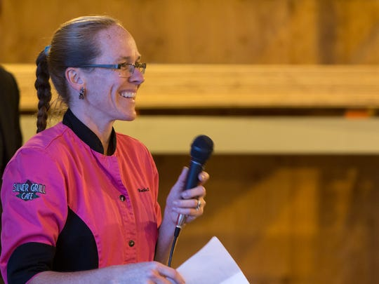 Chef Heather Beckman explains a course to diners during