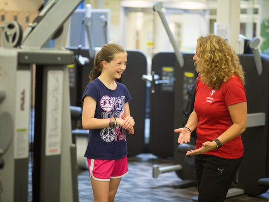 As part of the Y's free 7th Grade Memberships, students receive free Wellness Center Orientations. Wellness Specialist, Ginny Caporaso (right) gives Annie Kaczynski of Mendham instructions on how to safely use the weight machines.