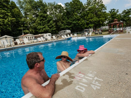 People hang out in the pool at Cherry Lane Nudist Resort in North Adams, Michigan on Friday June 10, 2016.
