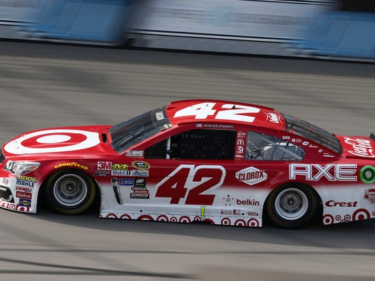 Sprint Cup Series driver Kyle Larson (42) races during