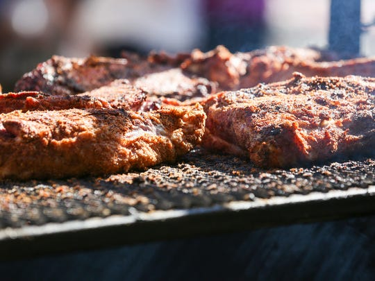 Meat barbecues at a food stand run by Salem-based Adam's Rib Smoke House at the Oregon State Fair on Sunday, Aug. 28, 2016.