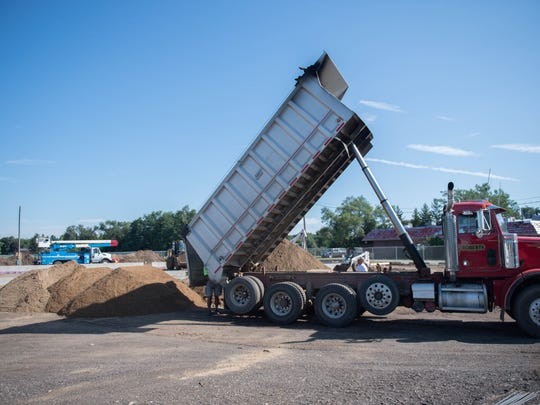 Dirt dumped from a truck Monday at the corner of 20th Street and Territorial Road in Battle Creek. A Finish Line Laundry location, the area's third, is expected to open on this spot early next year.